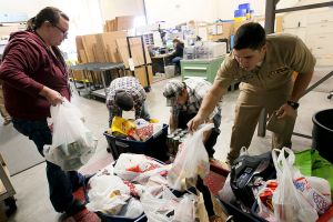 1024px-US_Navy_111123-N-HW977-185_Sailors_weigh_Thanksgiving_food_drive_donations_before_delivery_to_the_Corona-Norco_Settlement_House